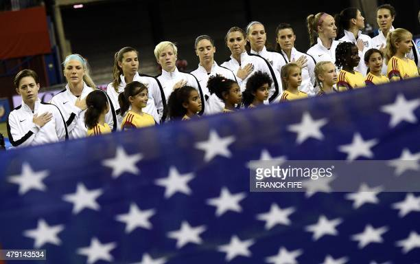 The USA team poses prior to their semifinal football match against Germany during the 2015 FIFA Women's World Cup at Olympic Stadium in Montreal on...