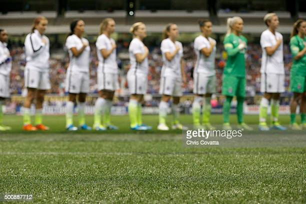 The USA team stands for the National Anthem on the artificial turf at the Alamodome before an international friendly match with Trinidad Tobago on...