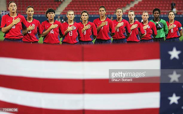 The USA womens football team line up for the singing of the national anthem before the start of the women's football gold medal match on August 26...