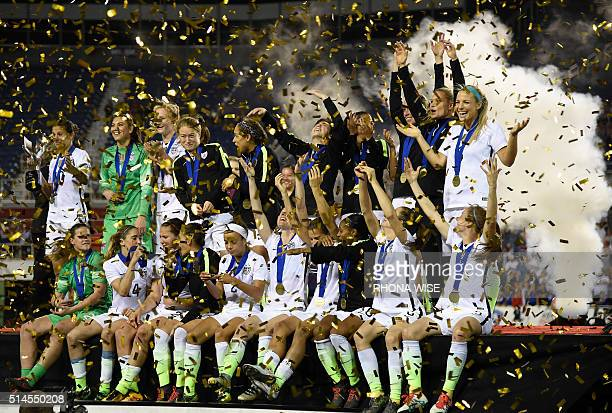 The USA women's national team celebrates their win of the SheBelieves Cup soccer tournament March 9 2016 in Boca Raton Florida / AFP / RHONA WISE
