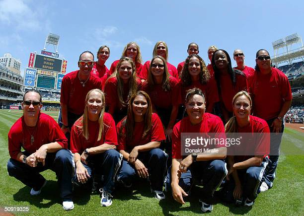 The USA Women's Olympic Softball team stand on home plate before the start of the Padres 21 win in the 10th inning over the Colorado Rockies at Petco...