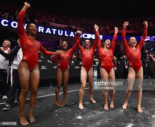 The USA women's team celebrate winning the gold medal in the Women's Team event final on the fifth day of the 2015 World Gymnastics Championship in...