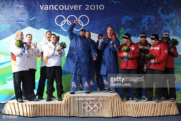 The USA1 fourman bobsleigh team celebratye winning gold with the German1 fourman bobsleigh team winning silver and the Canada1 fourman bobsleigh team...