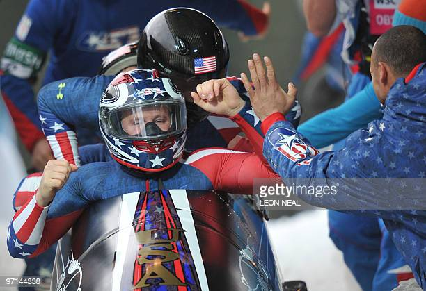 The USA1 fourman bobsleigh team piloted by Steven Holcomb celebrates winning gold in the 4man bobsleigh event at the Whistler sliding centre during...
