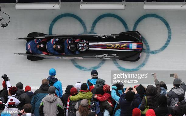 The USA1 fourman bobsleigh team piloted by Steven Holcomb during heat 3 of the 4man bobsleigh event at the Whistler sliding centre during the...