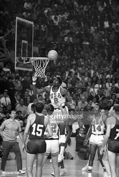 The USA's Spencer Haywood lays one up against Yugoslavia in final game of the Olympic basketball competition 10/25 At left is Yugo's Petar Skansi...