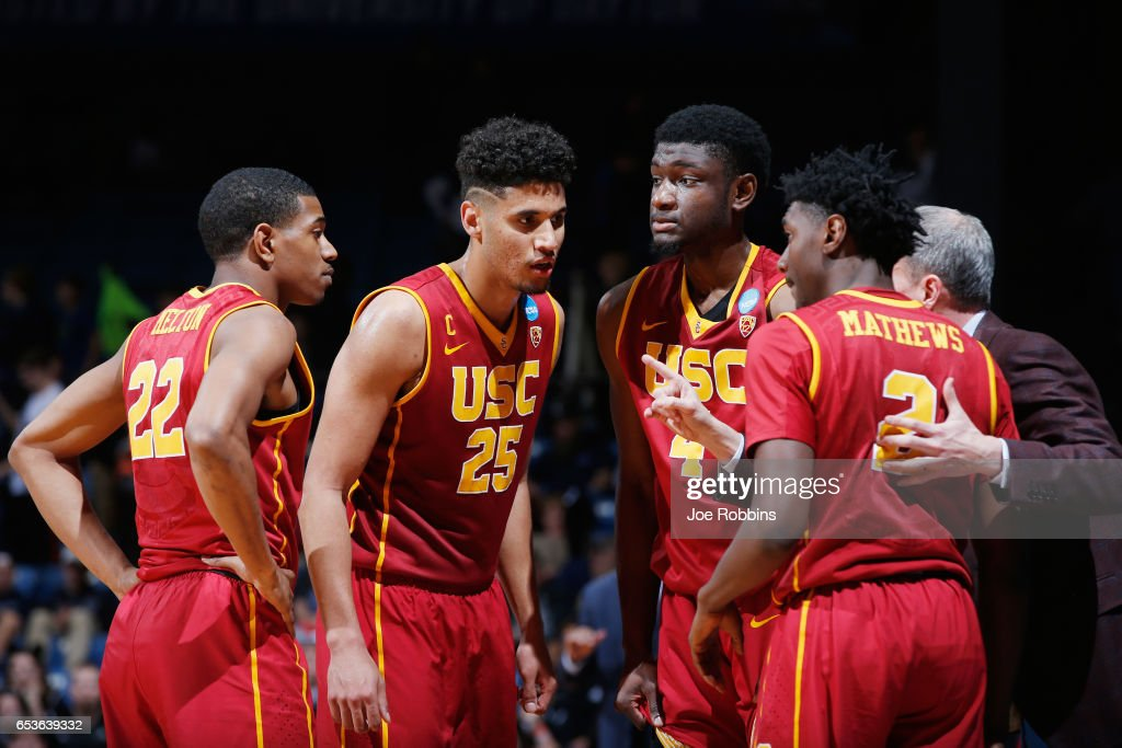 The USC Trojans huddle with head coach Andy Enfield in the second half against the Providence Friars during the First Four game in the 2017 NCAA Men's Basketball Tournament at UD Arena on March 15, 2017 in Dayton, Ohio.
