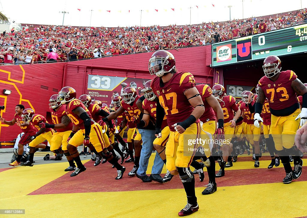The USC Trojans take to the field before the game against the Utah Utes at Los Angeles Memorial Coliseum on October 24, 2015 in Los Angeles, California.