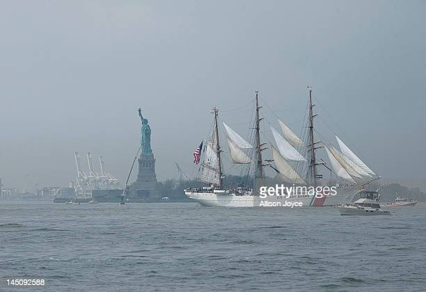 The USCGC Eagle passes the Statue of Liberty on the Hudson River during the Parade of Ships for the start of Fleet Week May 23 2012 in New York City...