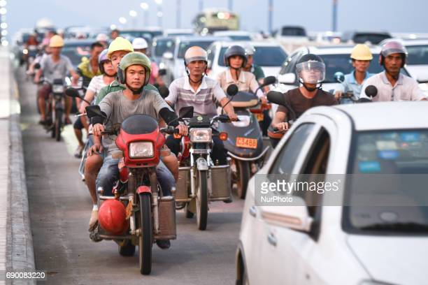The use of motorbikes is still very popular in modern China daily life A scene from the bridge over the Bei river in Qinqyuan On Saturday September...