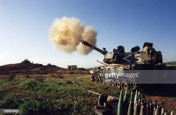 The USmade Israeli M109 selfpropelled 155 mm howitzer cannons pound Hezbollah targets in southern Lebanon from an artillery position at he...