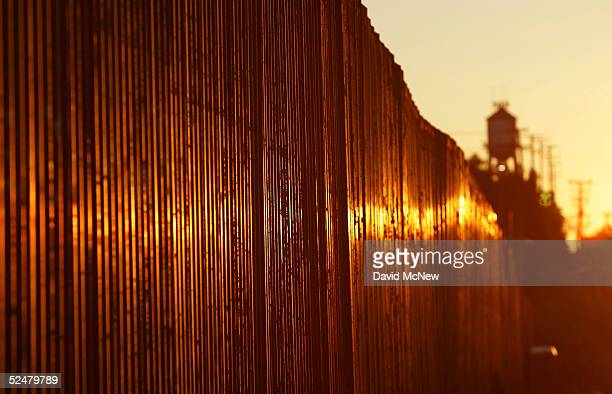 The USMexico border fence is seen at sunrise March 25 2005 near Calexico California Since the launch of the North American Free Trade Agreement in...