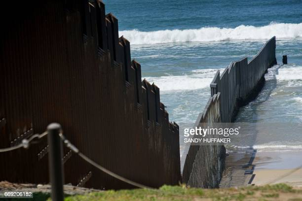 The USMexico border fence is seen prior to an Easter mass at the fence separating the two countries at Friendship Park in San Ysidro California on...