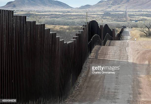 The USMexico border fence stretches into the countryside on January 21 2014 near Naco Arizona