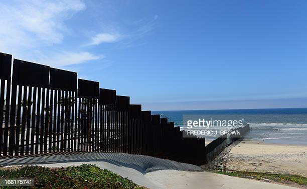 The USMexico 'borderfence' runs some three hundred feet into the Pacific Ocean in this most southwestern corner of the mainland United States across...