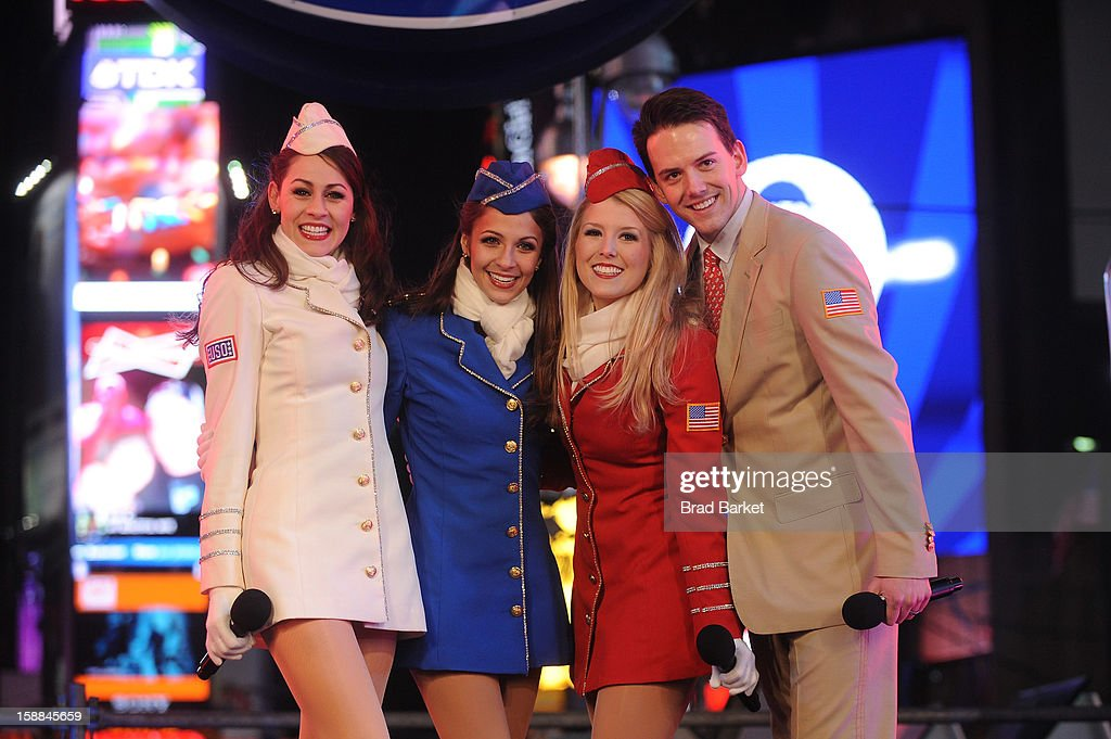 The USO's Liberty Bells perform their popular A Military Salute to honor our Armed Forces on the NIVEA Kiss Stage on New Year's Eve 2013 at Times Square on December 31, 2012 in New York City.