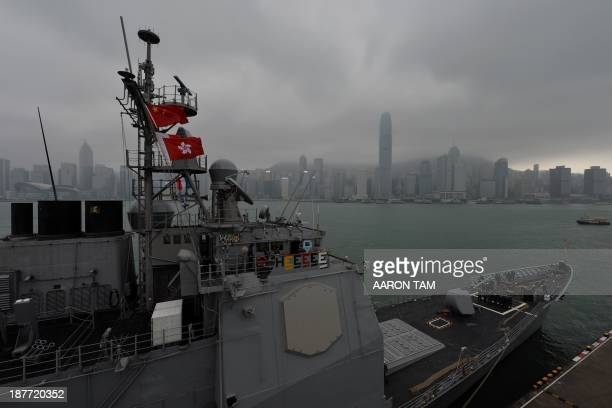 The USS Antietam a Ticonderoga class guided missile cruiser is seen moored in Hong Kong on November 12 2013 US Defense Secretary Chuck Hagel has...