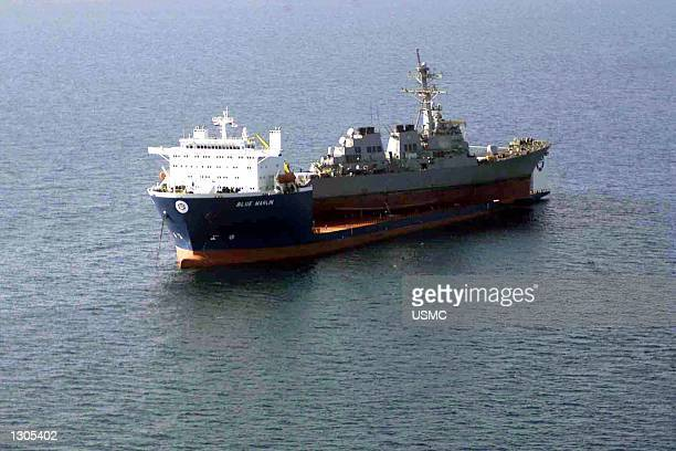 The USS Cole is lifted by MV Blue Marlin a Norwegian dry dock vessel off the coast of Aden Yemen October 31 2000 The American destroyer USS Cole was...