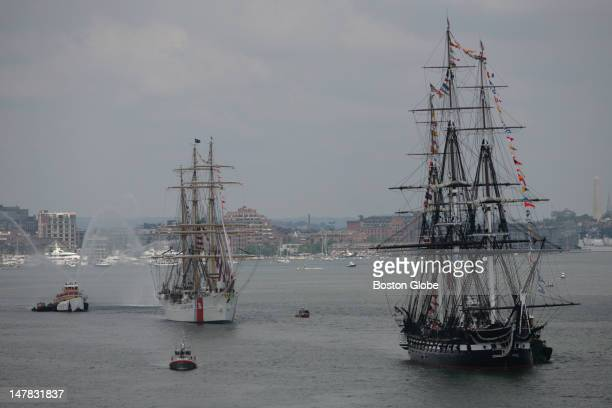 The USS Constitution and the USCG Eagle sail through Boston Harbor en route to perform a symbolic turnaround during Fourth of July celebrations