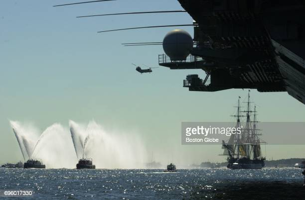 The USS Constitution sails towards the USS John F Kennedy during the Parade of Sail in Boston Harbor during Sail Boston on July 11 2000