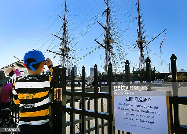 The USS Constitution was closed to onboard visitors because of the federal government shutdown A sign at the entrance tells the story