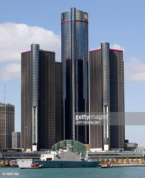 The USS Detroit comes up the Detroit River on the way to be docked in by the Renaissance Center in Detroit Michigan on October 14 2016 as seen from...