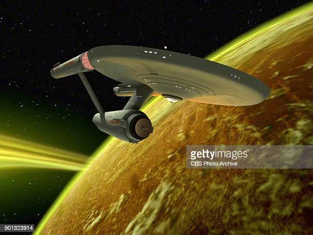 The USS Enterprise passing the planet Mudd an uninhabited K class planet This was the home world of the Mudd androids From episode 'I Mudd' of STAR...