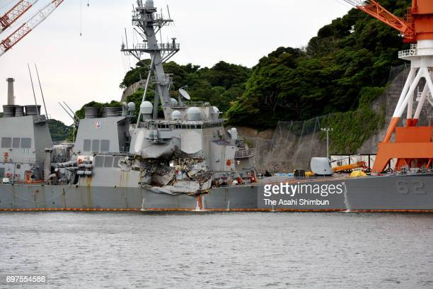 The USS Fitzgerald which suffered severe damage on the starboard side is anchored at the US naval base on June 18 2017 in Yokosuka Kanagawa Japan