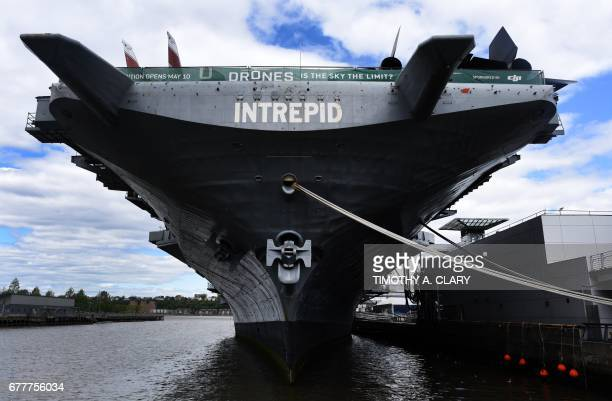 The USS Intrepid a decommissioned World War II aircraftcarrier now the Intrepid Sea Air and Space Museum is berthed on the Hudson River on May 3 2017...