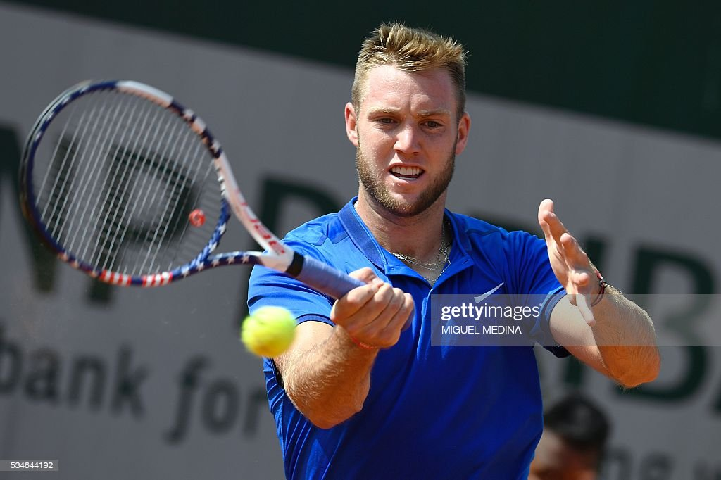 The US's Jack Sock returns the ball to Spain's Albert Ramos during their men's third round match at the Roland Garros 2016 French Tennis Open in Paris on May 27, 2016. / AFP / MIGUEL