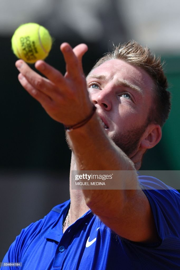 The US's Jack Sock serves the ball to Spain's Albert Ramos during their men's third round match at the Roland Garros 2016 French Tennis Open in Paris on May 27, 2016. / AFP / MIGUEL