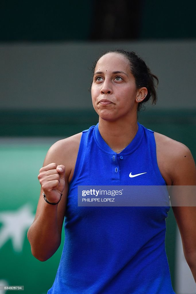 The US's Madison Keys reacts after winning a point during her women's third round match against Puerto Rico's Monica Puig at the Roland Garros 2016 French Tennis Open in Paris on May 28, 2016. / AFP / PHILIPPE