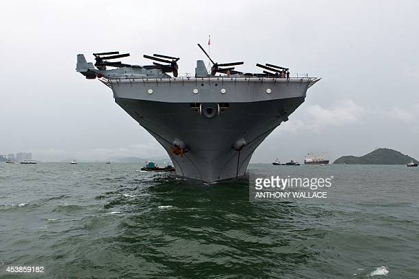 The USS Makin Island ship is seen anchored in Hong Kong waters on August 20 2014 Makin Island a Waspclass amphibious assault ship and the second ship...
