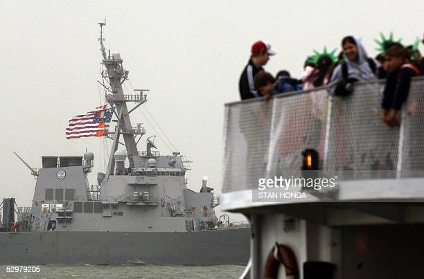 The USS Porter passes a tour boat filled with sightseers 25 May in New York harbor during the Parade of Ships to kick off Fleet Week The annual...