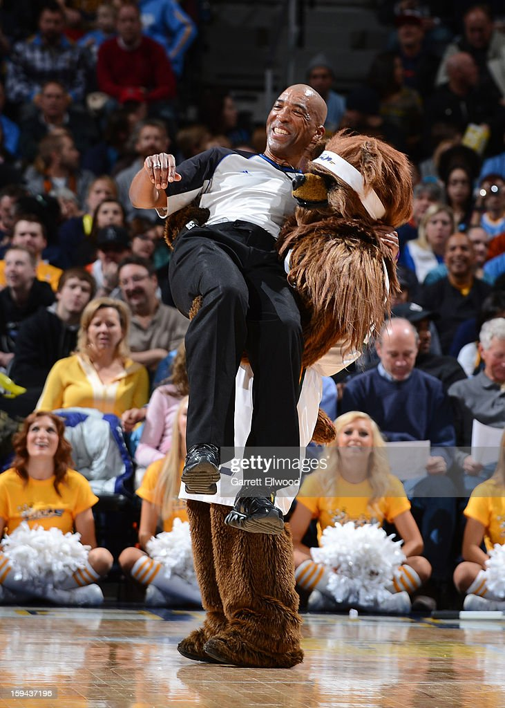 The Utah Jazz Bear mascot picks up the referee during the game between the Golden State Warriors and Denver Nuggets on January 13, 2013 at the Pepsi Center in Denver, Colorado.
