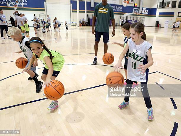The Utah Jazz participate in a Junior Jazz Generations event held during the Jr NBA week at Zions Basketball Center on October 21 2015 in Salt Lake...