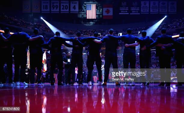 The Utah Jazz stand together during the national anthem prior to Game Seven of the Western Conference Quarterfinals against the Los Angeles Clippers...