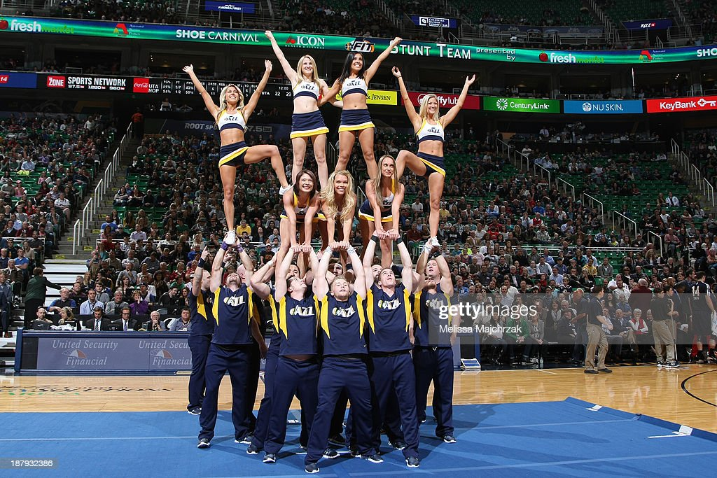 The Utah Jazz stunt team performs during the game against the New Orleans Pelicans at EnergySolutions Arena on November 13, 2013 in Salt Lake City, Utah.