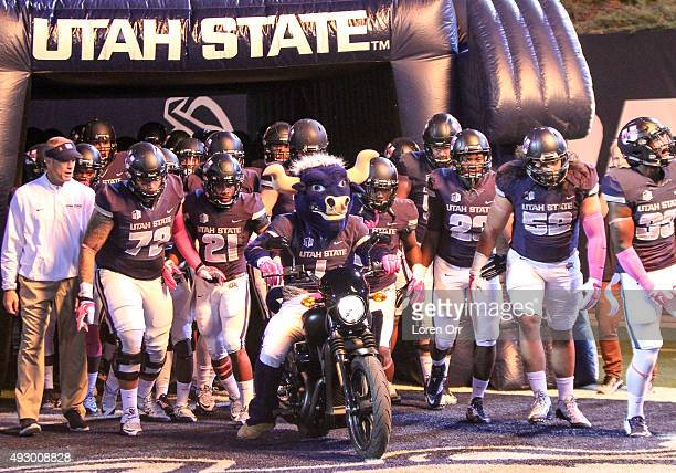The Utah State Aggies enter the field prior to the start of football action between the Boise State Broncos and the Utah State Aggies on October 16...