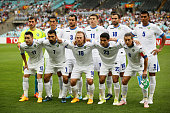 The Uzbekistan team line up before the 2015 Asian Cup match between Uzbekistan and DPR Korea at ANZ Stadium on January 10 2015 in Sydney Australia