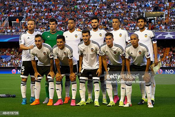 The Valencia CF team pose prior to the UEFA Champions League Qualifying Round Play Off First Leg match between Valencia CF and AS Monaco at Mestalla...