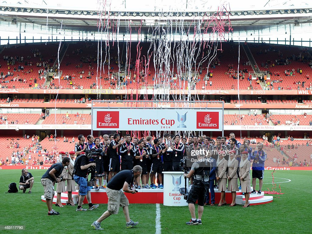 The Valencia team lift the Emirates Cup Trophy after the Emirates Cup match between Arsenal and AS Monaco at Emirates Stadium on August 3, 2014 in London, England.