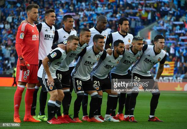 The Valencia team line up for a photo prior to kick off during the La Liga match between Espanyol and Valencia at CornellaEl Prat stadium on November...