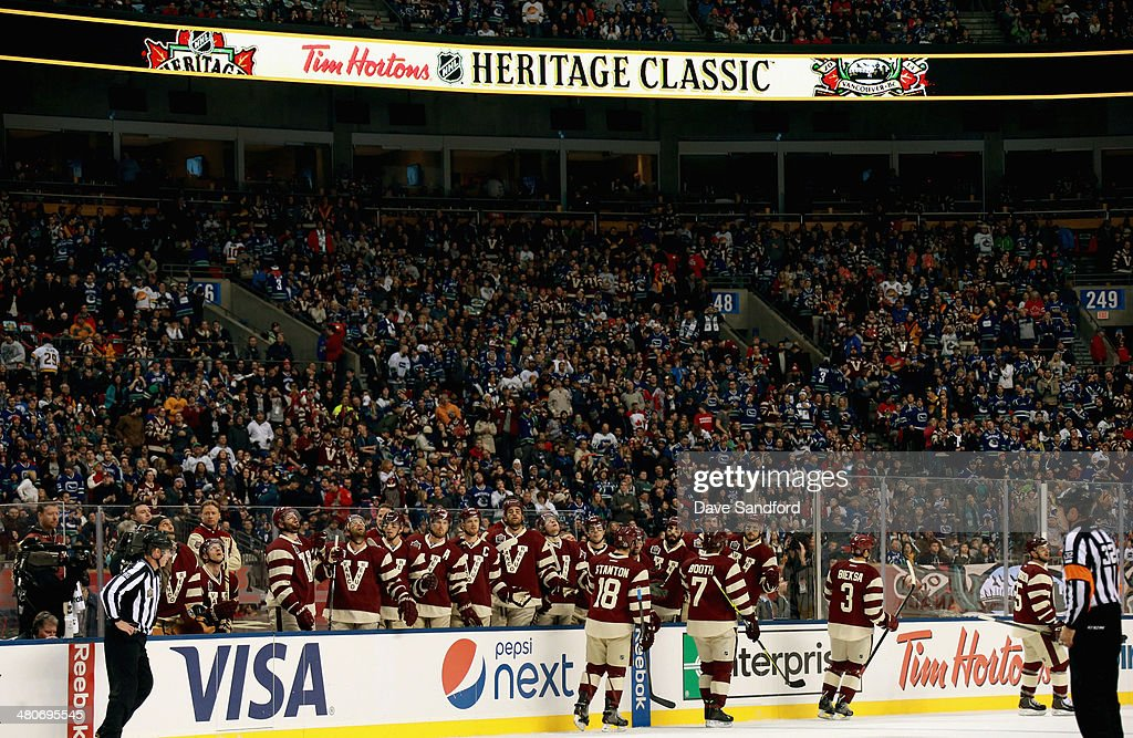 The Vancouver Canucks celebrate a goal against the Ottawa Senators during the first period of the 2014 Tim Hortons NHL Heritage Classic game at BC Place on March 2, 2014 in Vancouver, British Columbia, Canada.