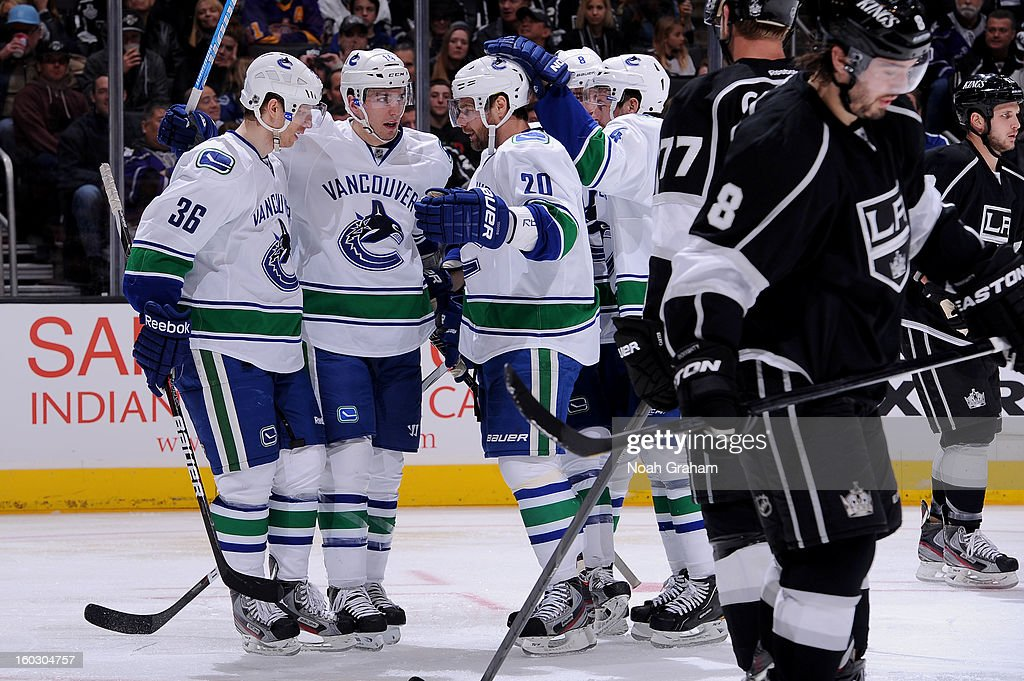 The Vancouver Canucks celebrate after a goal against the Los Angeles Kings at Staples Center on January 28, 2013 in Los Angeles, California.
