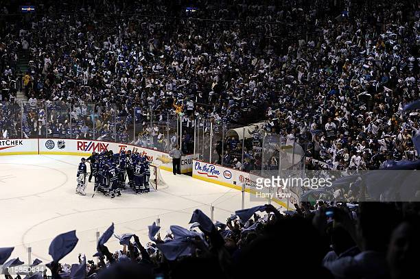 The Vancouver Canucks celebrate after defeating the Boston Bruins by a score of 10 in Game Five of the 2011 NHL Stanley Cup Final at Rogers Arena on...