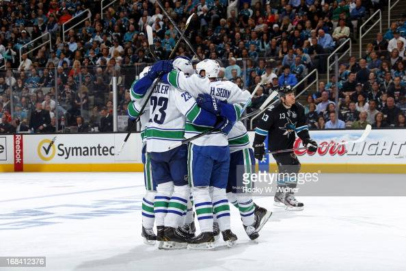 The Vancouver Canucks celebrate after scoring a goal against the San Jose Sharks in Game Four of the Western Conference Quarterfinals during the 2013...