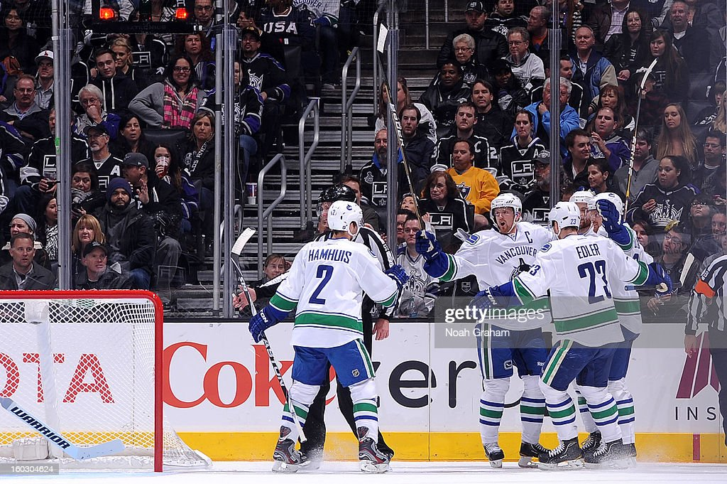 The Vancouver Canucks celebrate atfer a goal against the Los Angeles Kings at Staples Center on January 28, 2013 in Los Angeles, California.