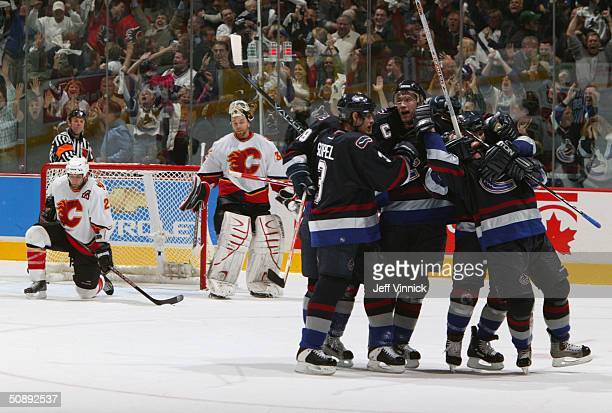 The Vancouver Canucks celebrate during the first round NHL playoff game against the Calgary Flames at the General Motors Place on April 19 2004 in...