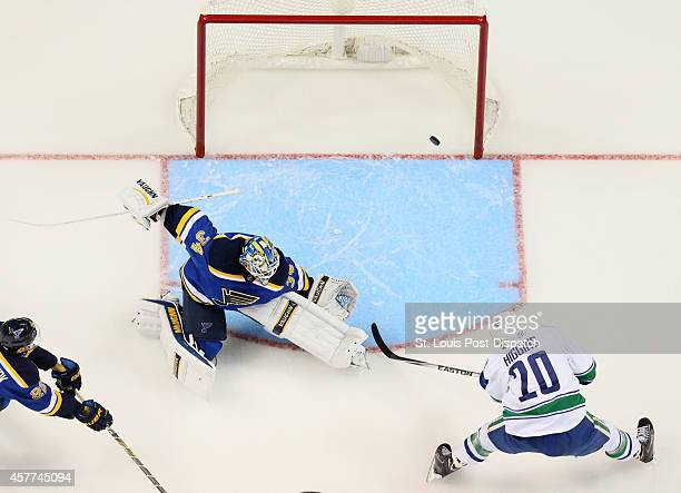 The Vancouver Canucks' Chris Higgins scores past St Louis Blues goaltender Jake Allen in firstperiod action on Thursday Oct 23 at the Scottrade...